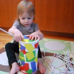 How to upcycle an oatmeal container into a straw game for babies or toddlers.